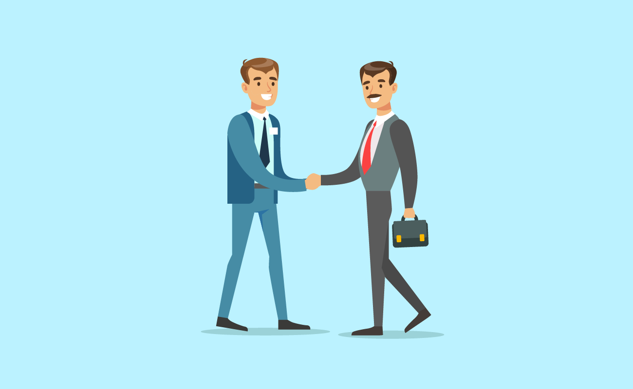Businessman shaking hands with lender.