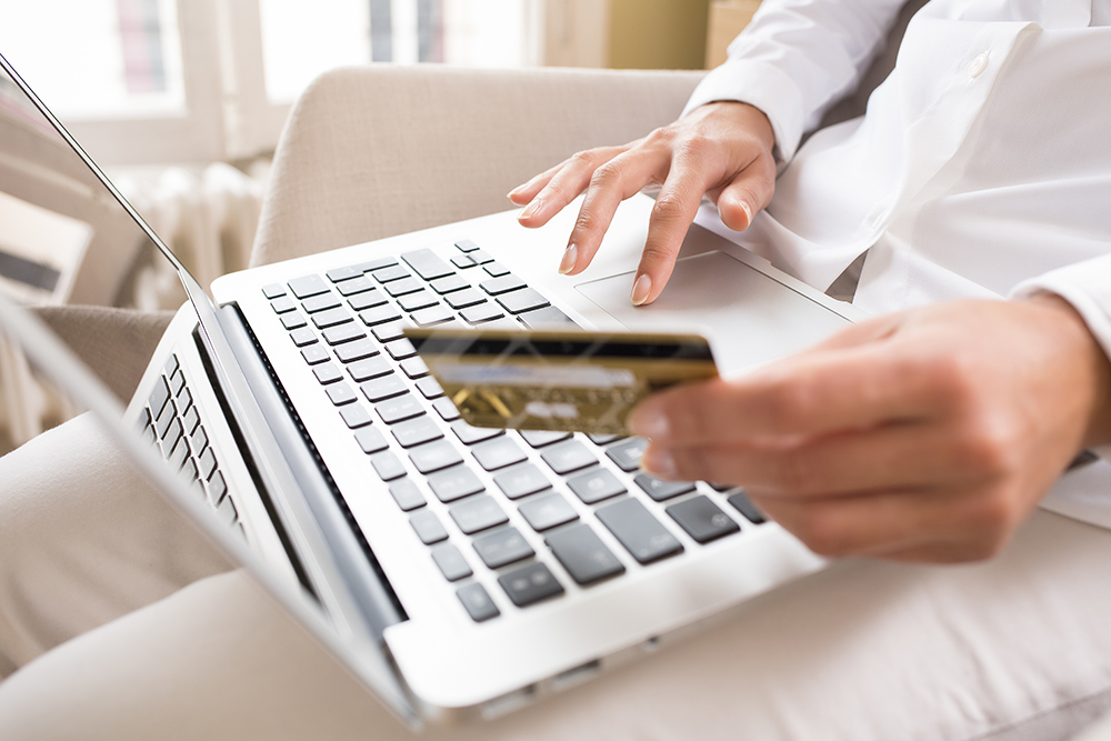 Using Credit Card to Shop On a Laptop Computer.