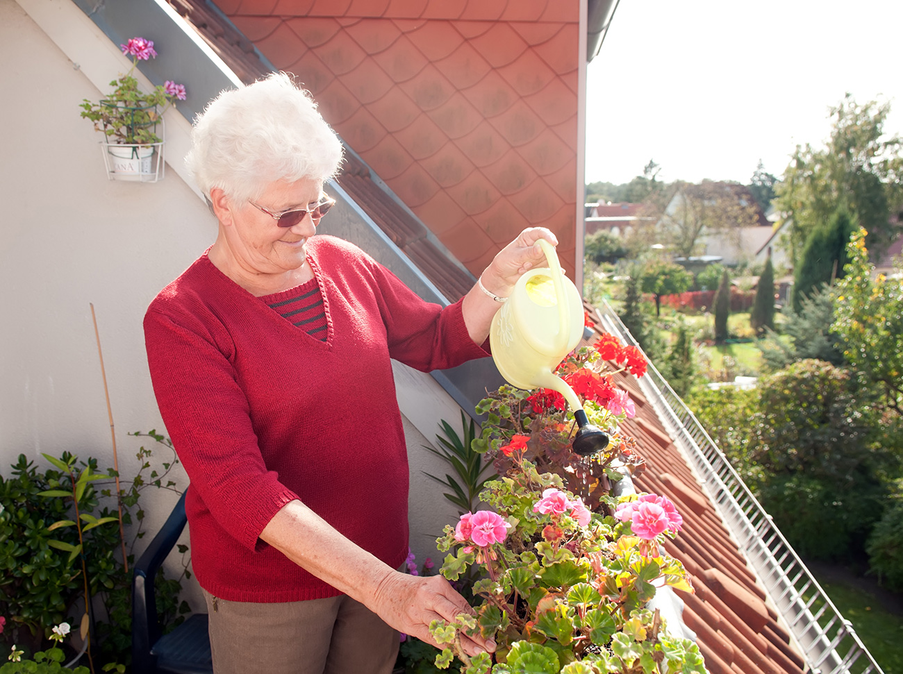 Grandmother Watering Flowers.