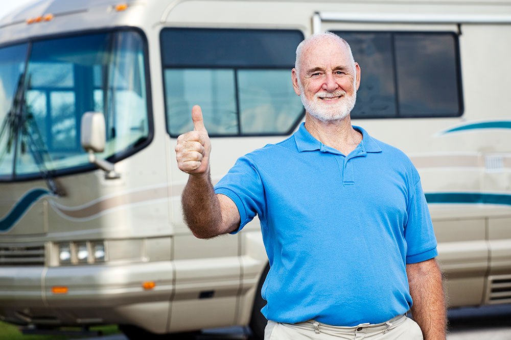 Man with an RV giving thumbs up.