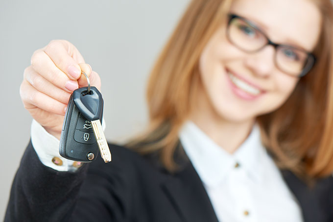 Womain Smiling Holding Car Keys.